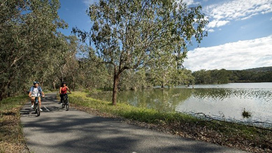 Couple cycling on the scenic Wagirra Trail, West Albury situated alongside the Murray River