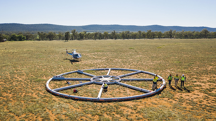 Helicopter on the ground with equipment used for airborne electromagnetic (AEM) survey to detect minerals and groundwater