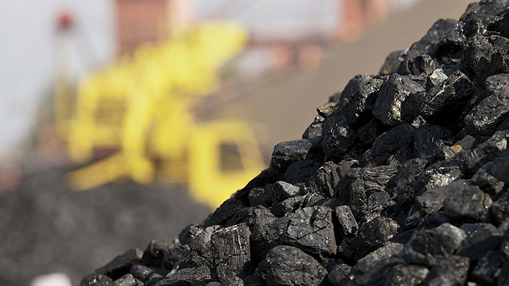 Coal piled up at a mine site