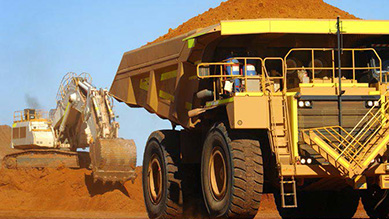 Large mining truck laden with ore in mining site