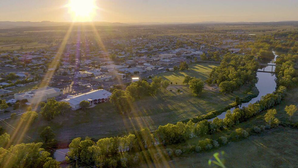 Aerial image of Narrabri with sun peaking over the mountains